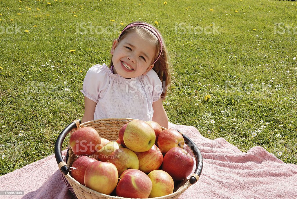 girl and apples on a meadow royalty-free stock photo