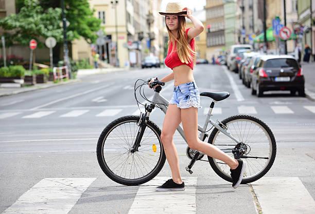 girl and bicycle in summer city, copy space - praga boémia - fotografias e filmes do acervo