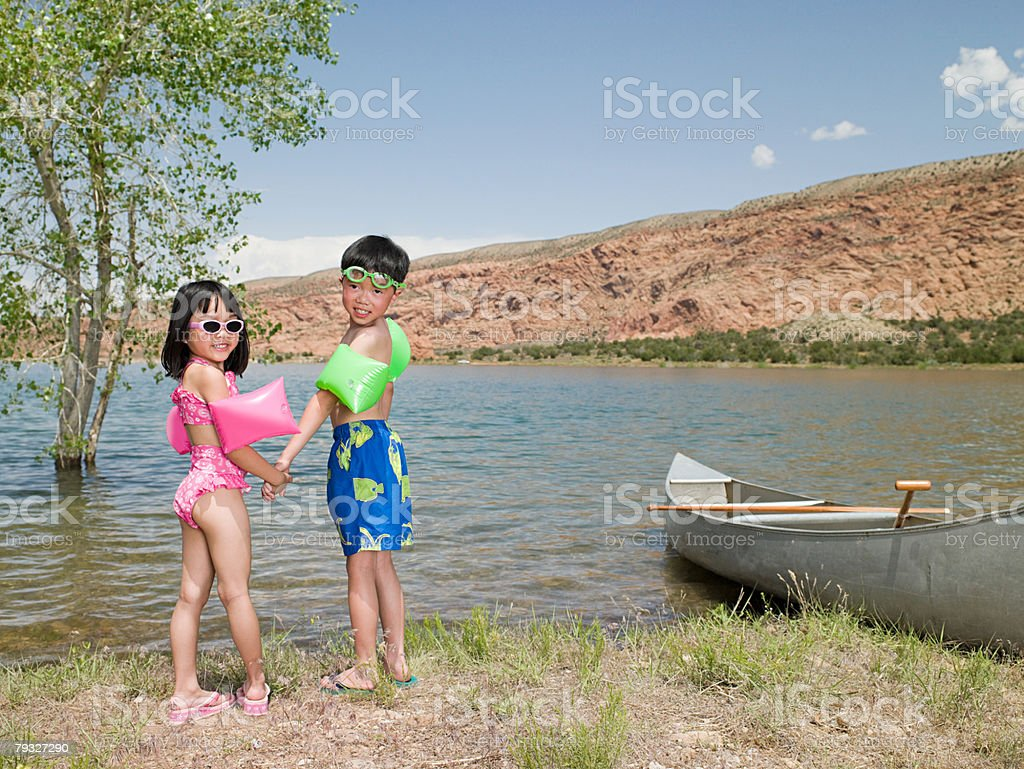 Girl and boy by lake royalty-free stock photo