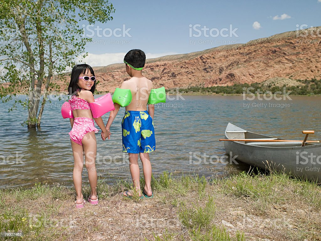 Girl and boy by lake 免版稅 stock photo