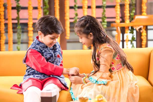 Girl and boy celebrating Raksha Bandhan festival stock photo