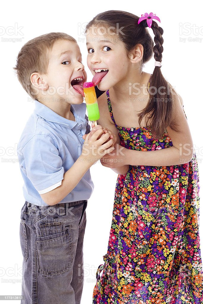 Girl And Boy Eating Ice Cream Together Royalty Free Stock Photo