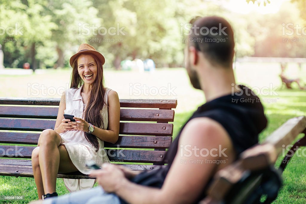 Girl and boy flirting stock photo