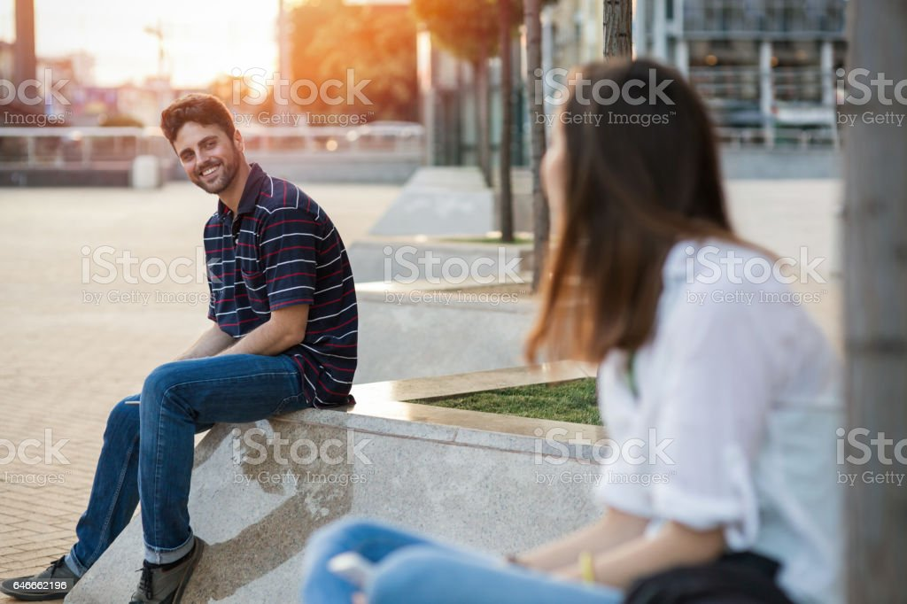 Girl and boy getting acquainted with each other stock photo