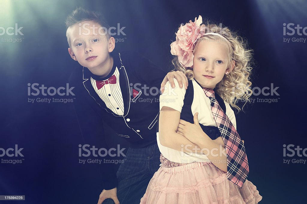 Girl and boy in flash light royalty-free stock photo