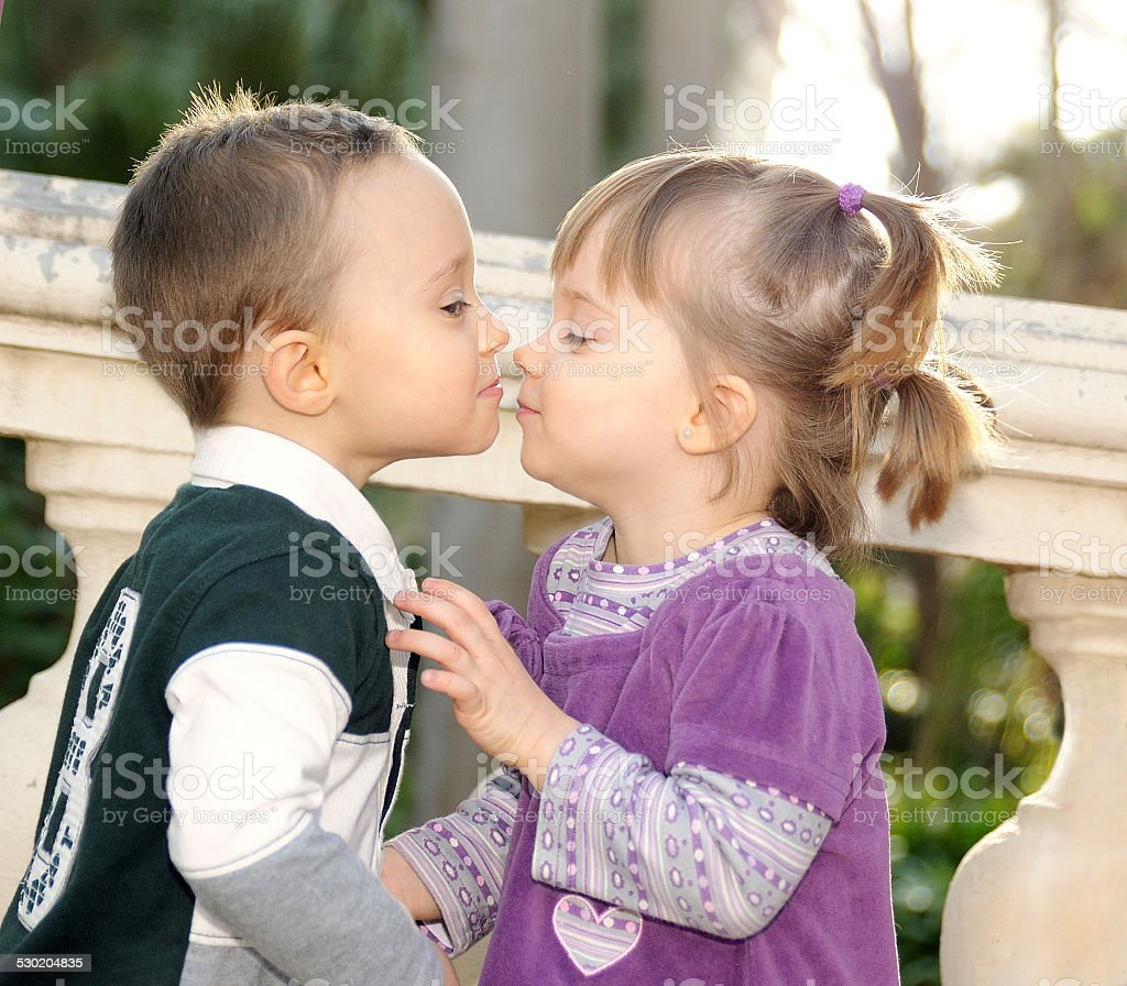 Girl And Boy Kissing Tenderly In The Park Stock Photo -3049