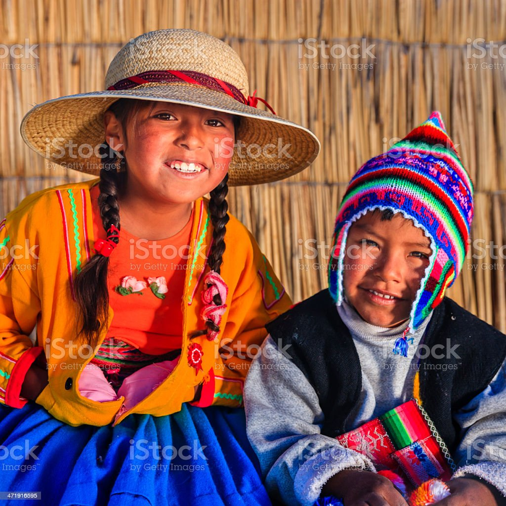 Girl and boy on Uros floating island, Lake Tititcaca, Peru stock photo