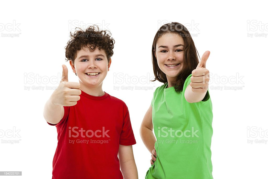 Girl and boy showing OK sign stock photo