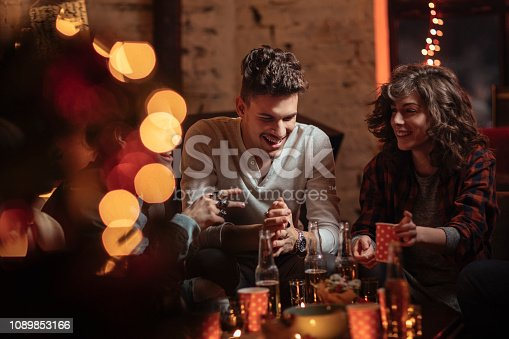 Couple talking and laughing at Christmas party