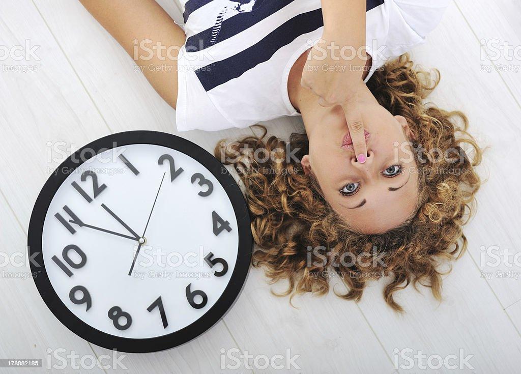 Girl and clock silence secret stock photo