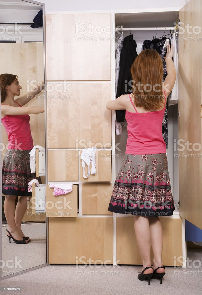 Girl and Closet royalty-free stock photo