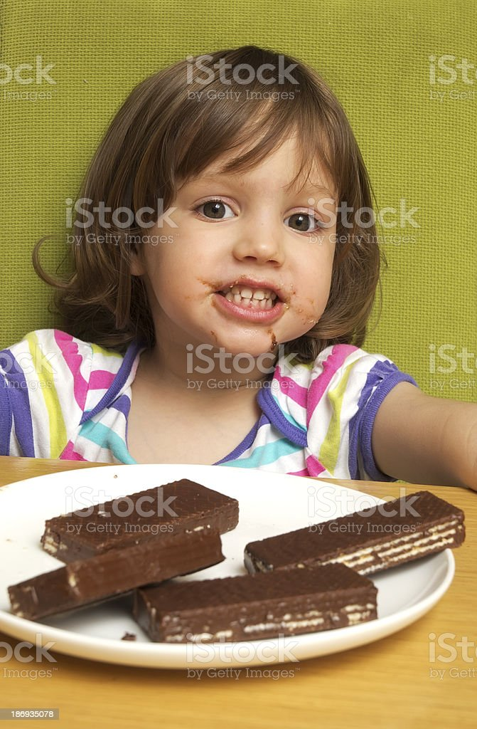 Girl and cookies royalty-free stock photo