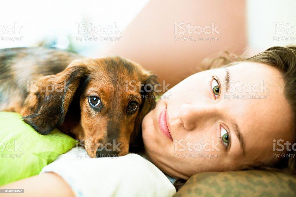 Girl and Dachshund stock photo