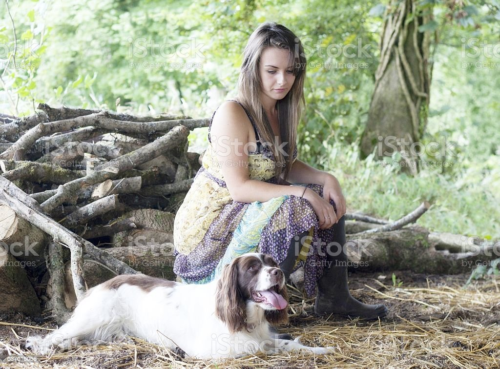 girl and dog in country setting stock photo