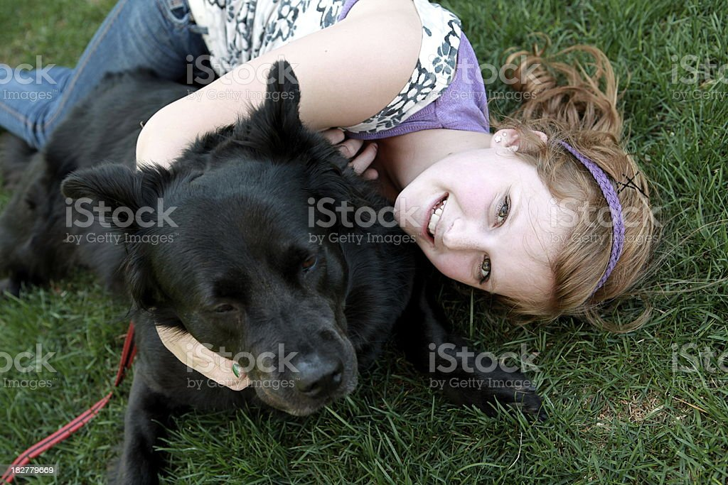 Girl and Dog in Grass royalty-free stock photo