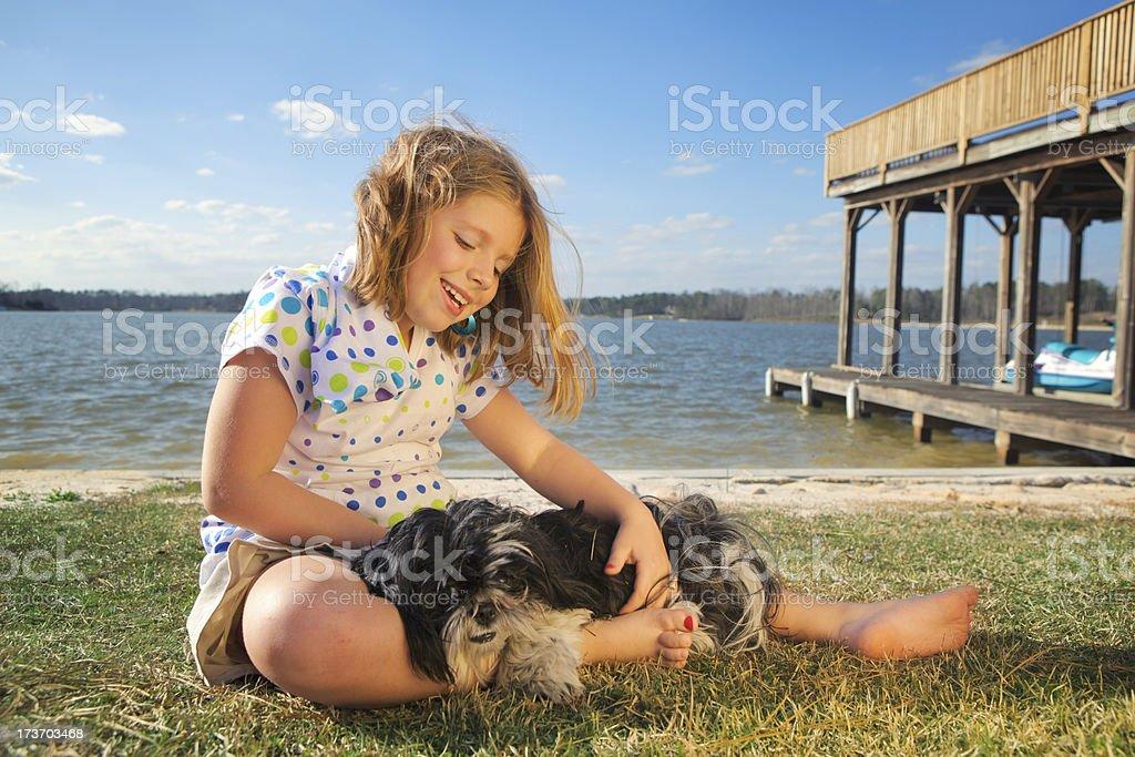 Girl and Doggy at the Lake royalty-free stock photo