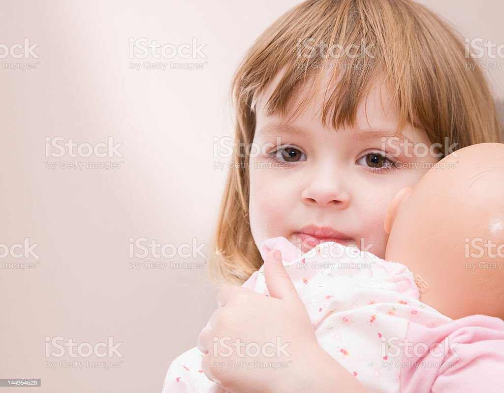 girl and doll stock photo