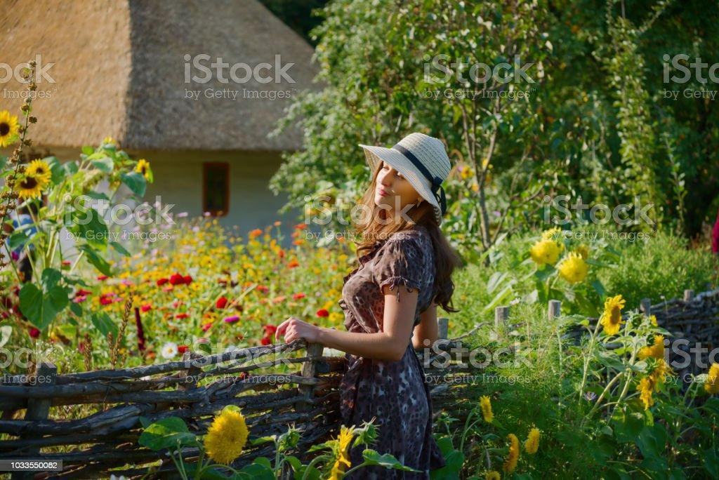 Girl and ethnic Ukrainian village stock photo