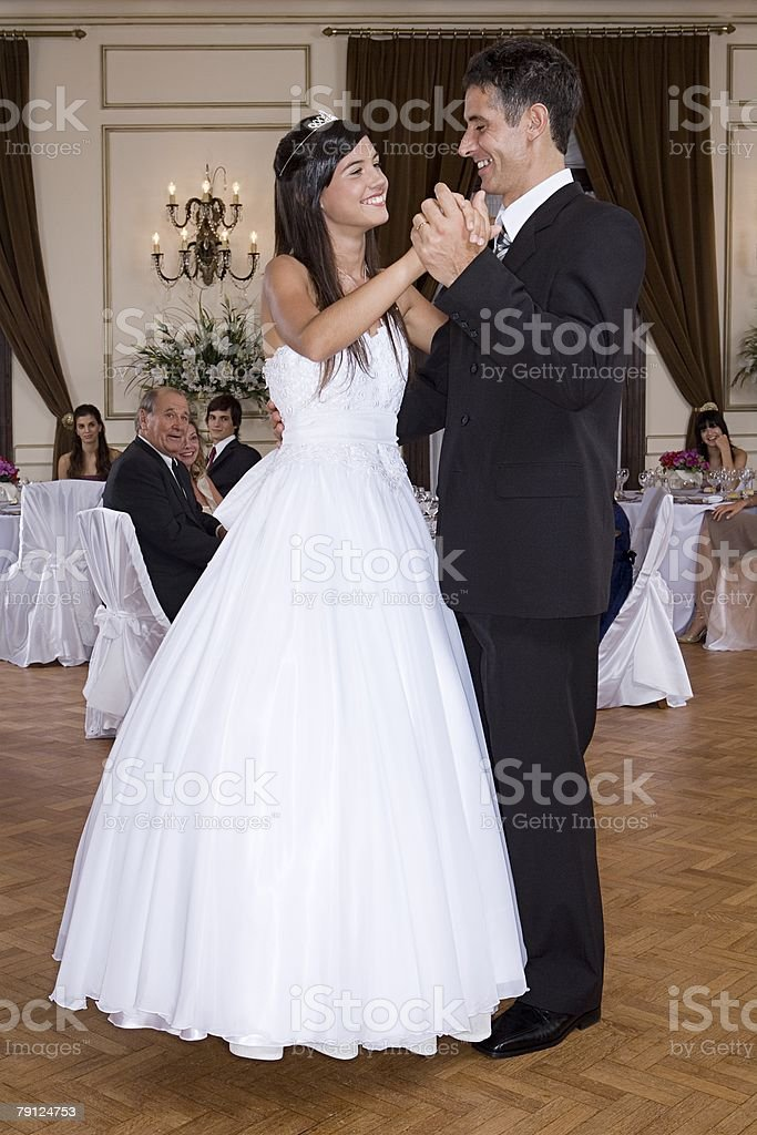 Girl and father dancing at quinceanera stock photo