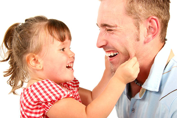 Girl and Father playing stock photo