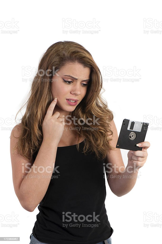 Girl and floppy disk royalty-free stock photo