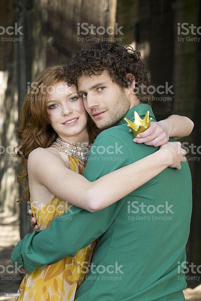 Girl and frog prince stock photo