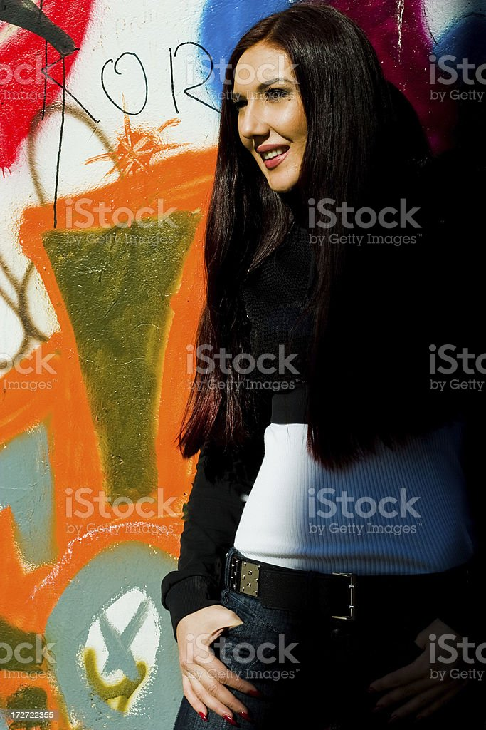 Girl and graffiti wall. stock photo