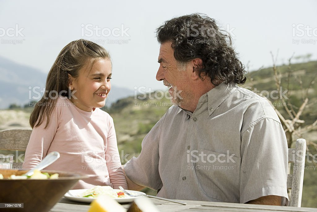 Girl and grandfather royalty-free stock photo