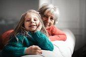 girl and grandma on a sofa