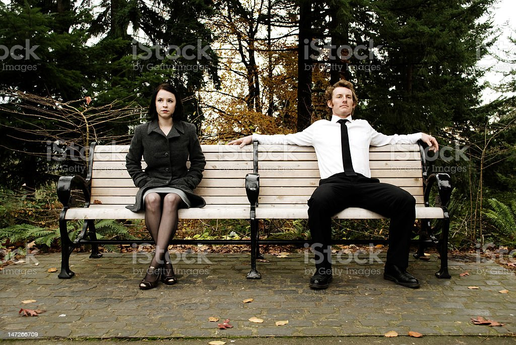girl and guy sitting on parkbench royalty-free stock photo