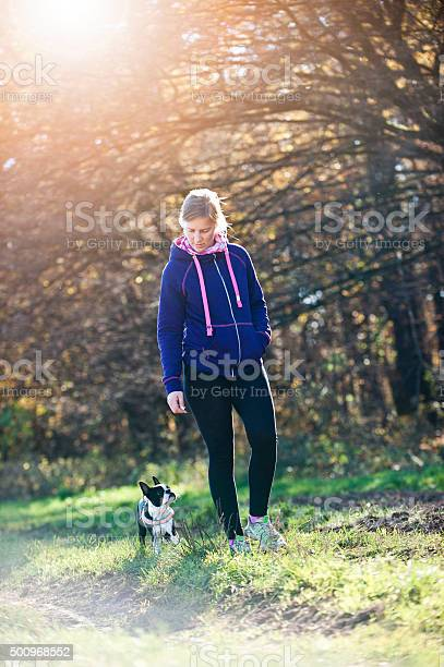 Girl and her dog walking in a park picture id500968552?b=1&k=6&m=500968552&s=612x612&h=3mlsipdrs2bw0jujdpotzg7ocfa4t68qoqt2lzyqvny=