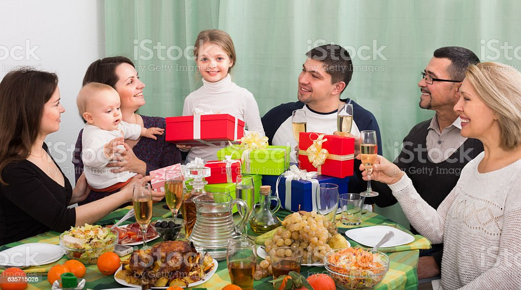 girl and her family celebrating royalty-free stock photo