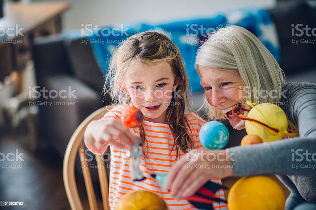 Girl and her Grandma Exploring Space stock photo
