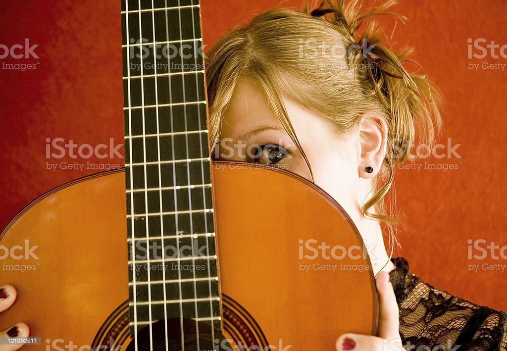 Girl and her Guitar royalty-free stock photo