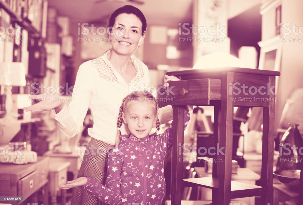 girl and her mother are choosing  curbstone stock photo