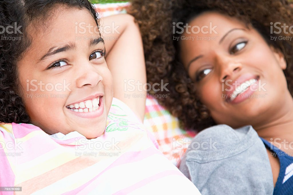 Girl and her mother 免版稅 stock photo