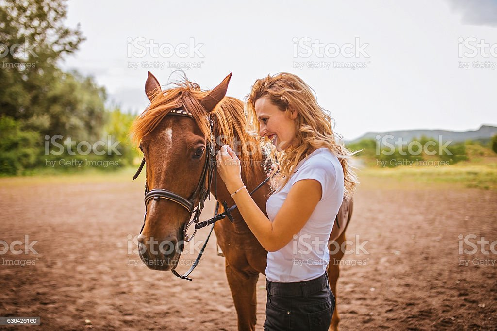 Girl and her pet horse stock photo