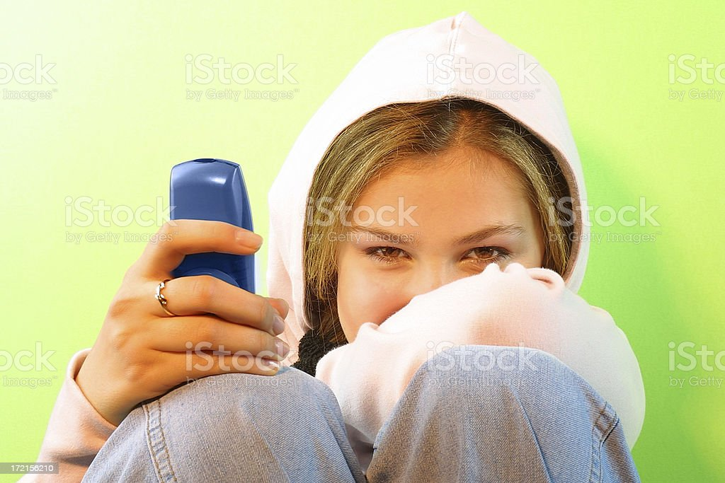 Girl and her phone royalty-free stock photo