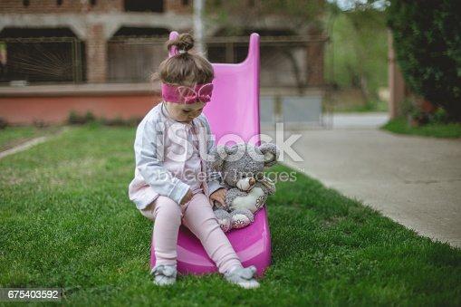678589610istockphoto Girl and her teddy bear 675403592