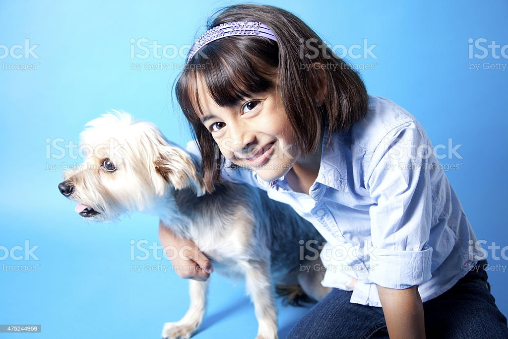Girl and her Yorkie puppy royalty-free stock photo