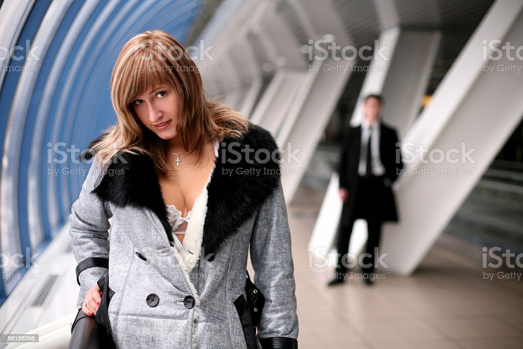 girl and man in city, rainy day, inside bridge stock photo