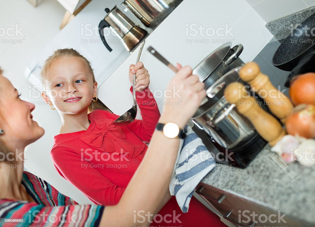 girl and mom with pot royalty-free stock photo