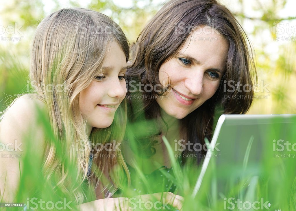 Girl and mommy online royalty-free stock photo