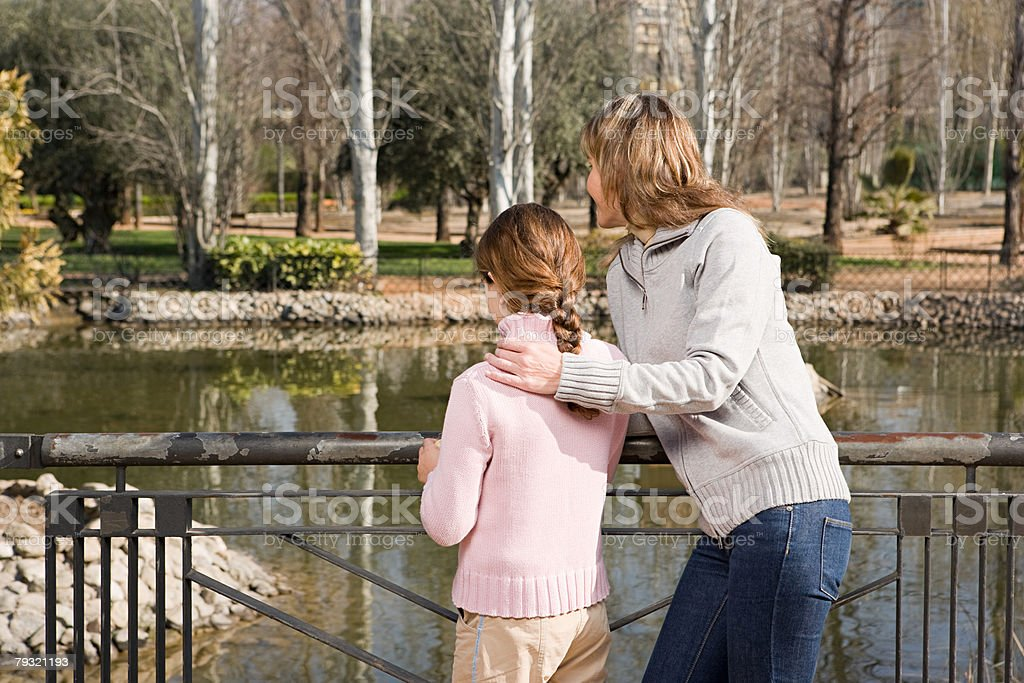 Girl and mother by lake royalty-free 스톡 사진