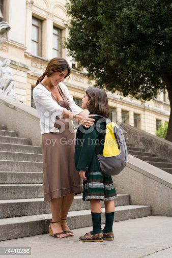 istock Girl and mother outside school 74410286