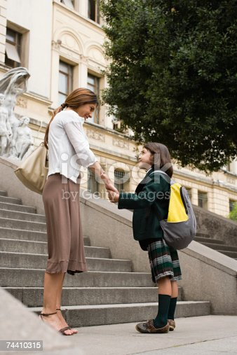istock Girl and mother outside school 74410315