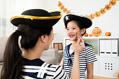 istock girl and mother play Halloween makeup 1021043886