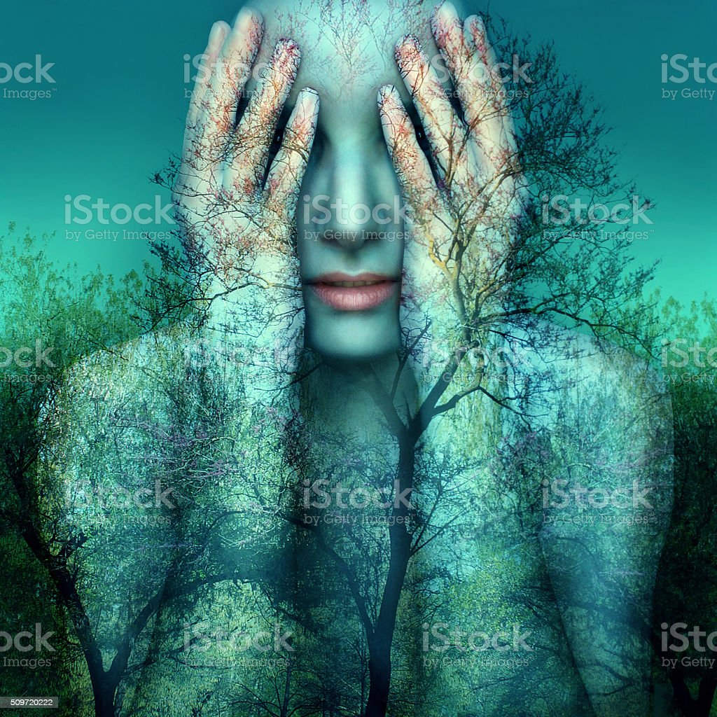 Girl and nature in blue stock photo