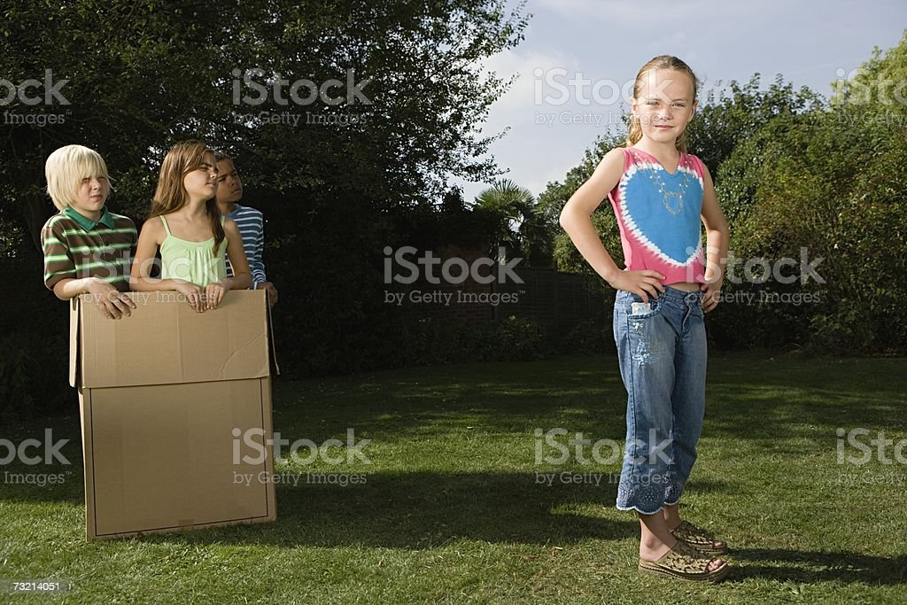 Girl and other children in a cardboard box royalty-free stock photo