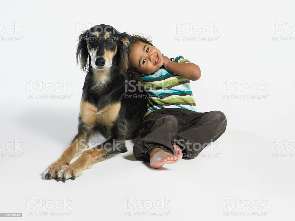 Girl and pet dog stock photo